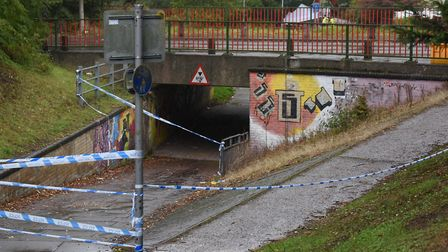 The underpass under Brandon Road in Thetford with the police tents in the background after a man is