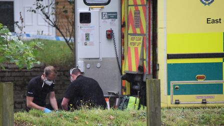 An ambulance at the scene where a man is believed to have been stabbed at Brandon Road in Thetford.