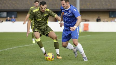 Lowestoft's Jacek Zielonka up against Carshalton's Danny Dudley Picture: Shirley D Whitlow