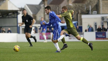 Lowestoft's Dylan Williams on the run. chased by Carshalton Athletic player Ernold Haxhiu Picture: S