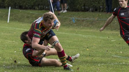 Tom Lloyd makes a break for Norwich during their hard-fought win at South Woodham Ferrers Picture: A