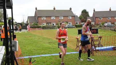 Ginny Fellows at the end of the Bure Valley 10. Picture: Total Race Timing