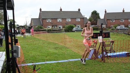 Alice Horney finishes the Bure Valley 10. Picture: Total Race Timing