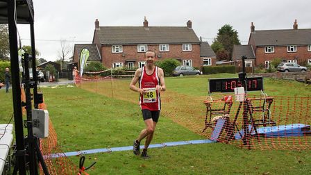 John Moore crosses the Bure Valley 10 finish line. Picture: Total Race Timing