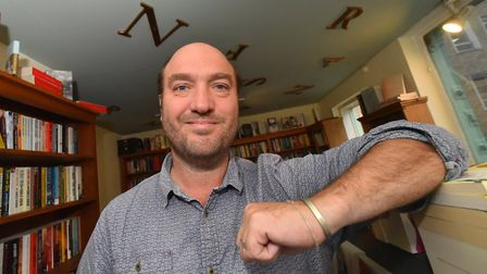 Henry Layte of The Book Hive, which is celebrating ten years in business. Picture: Jamie Honeywood