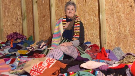 St Martins, the homeless charity, have constructed a woollen house out of scarfs in Norwich Carhedra