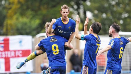Celebration time for King's Lynn Town's two-goal hero Adam Marriott Picture: Ian Burt Photography