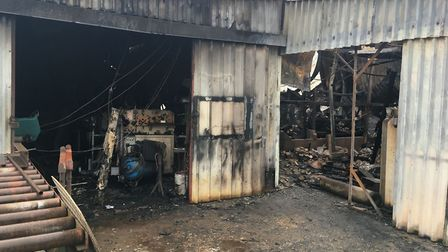 A fire at Randells Garden Machinery off Shipdham Road in Toftwood, Dereham, has left one person inju