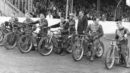 The 1959 Norwich team line up at The Firs where the crowd waits for the action to begin. Picture: Mi