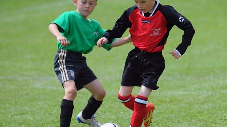Youngsters take part in the Junior Football tournament at Taverham. Picture Simon Parker.