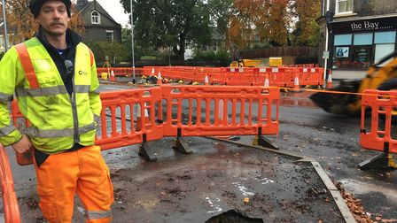 Supervisor Ollie Bell next to the Earlham Road sinkhole in Norwich which appeared on November 6, 201