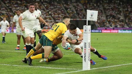 England's Ben Youngs is tackled into touch by Australia's Nick White as he attempts to score a try d