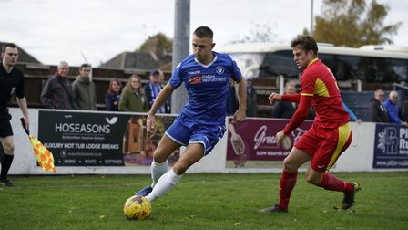 Lowestoft's Jake Reed comes under pressure from Needham player Callum Sturgess Picture: Shirley D W