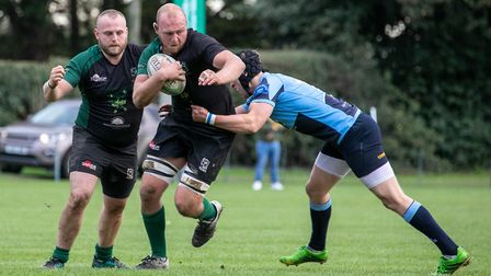 Ryan Oakes is supported by Tom Knight as North Walsham take the game to Eton Manor Picture: HYWEL JO