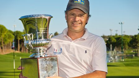 Norfolk professional Andrew Marshall lifts an impressive trophy after his big win in Turkey Picture: