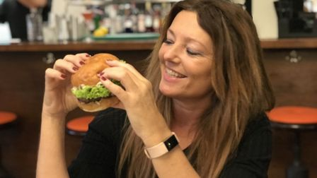 Business correspondent Caroline Culot gets to try the Dirty Harry burger before opening night. Pic: