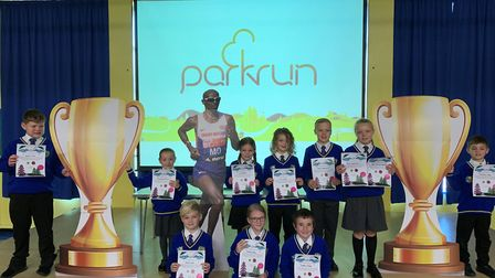 Pupils at Howard Junior School in King's Lynn take part in a junior Parkrun in the town to help them