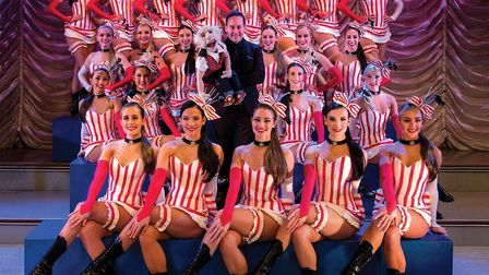Steve Hewlett and dancers in costume for the Thursford Christmas Spectacular 2019. Picture: THURSFOR