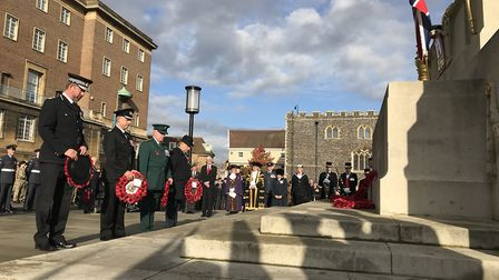 Representatives of the emergency services lay poppy wreaths at the Remembrance Day commemorations in