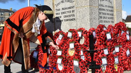Mayor of Lowestoft Councillor Alice Taylor inspects wreaths on the memorial. Photo: Mick Howes