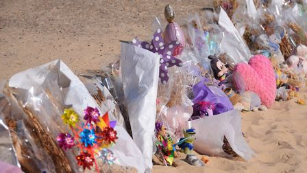 Flowers and toys left in memory of Ava May Littleboy at Gorleston beach. Picture: DENISE BRADLEY