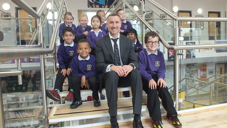 Stuart Allen, headteacher at Mile Cross Primary School, with year one and two pupils. Picture: New A
