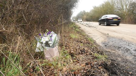 Floral tributes to Mark Rodwell, from Doncaster, who died in a lorry crash on the A47 at Scarning on