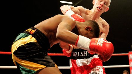 Michael Walsh in action during his professional boxing debut against Delroy Spencer at The ExCel Ce