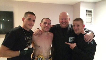 Michael Walsh, right, next to trainer Graham Everett and younger twin brothers Liam, left, and Ryan