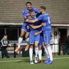 Lowestoft's Shaun Bammant, centre, is congratulated by Malachi Linton and Miguel Lopez at Rushall, b