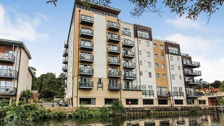 A two bedroom apartment with river views in Norwich is on the market for £240,000. Photo: Starkings