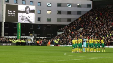 Fans and players pay tribute to Duncan Forbes before the Premier League match at Carrow Road, Norwic