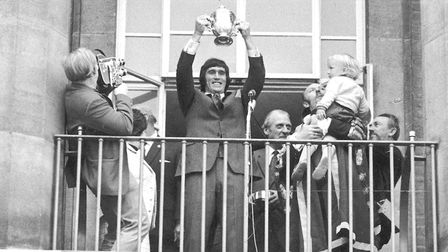 Duncan Forbes holding aloft the Division Two trophy at City Hall in 1972 Picture: Archant