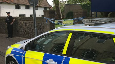 Police at St Marys Church in Diss after a man was was found dead in the church yard. Picture: Simon