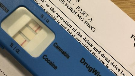 A man was arrested on suspicion of drug driving after parking in the middle of the main road with a