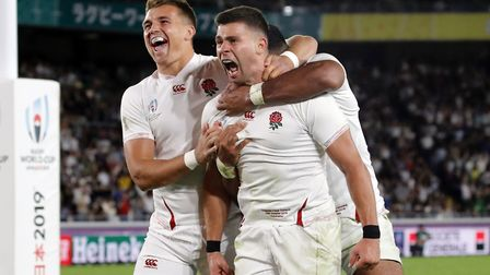 England's Ben Youngs, right, celebrates with teammates after scoring a try during the Rugby World Cu