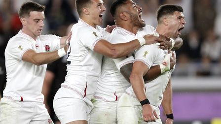 England teammates celebrate a try by Englands Ben Youngs, right, from Norfolk that was overturned af