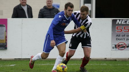 Lowestoft's Dylan Williams battling with Coalville captain Steve Towers Picture: Shirley D Whitlow