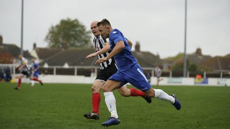 Blues striker Jake Reed on the run, with Jack Duggan in close attendance Picture: Shirley D Whitlow