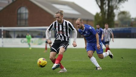 Lowestoft midfielder Andrew Fisk shadows Coalville's Joe Doyle-Charles Picture: Shirley D Whitlow