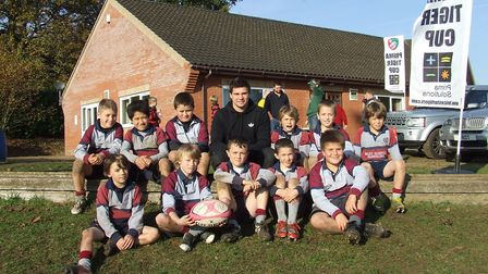 West Norfolk Under-10s are pictured with Tigers and England scrum-half Ben Youngs. Picture: Archant