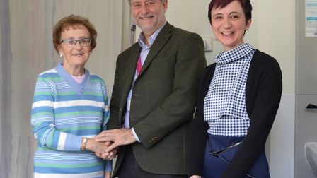Malcolm Porter's wife Freda (left) and daughter Julie (right) with Dr Jeff Cochius, NNUH Consultant