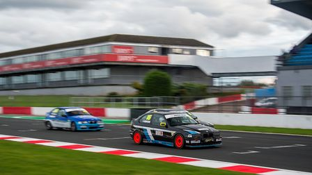 Tom Griffiths fighting his way back to second place in the opening BMW Compact Cup race at Donington