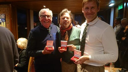 Celebrating their success in Scotland are Andrew Marshall (centre), George Pledger (right) and fello