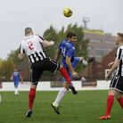 Lowestoft's new signing Ollie Saunders and Coalville's Stuart Pierpoint in aerial combat during last