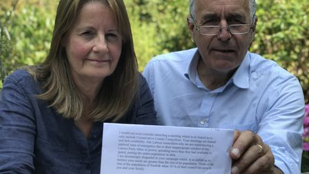 Judith and Nick Taylor from Buxton with the email they received from Norfolk County Councillor Marga