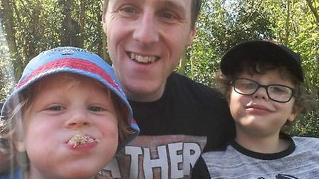 Jamie Weller and his sons, five and eight, at New Buckenham allotments. Photo: Jamie Weller
