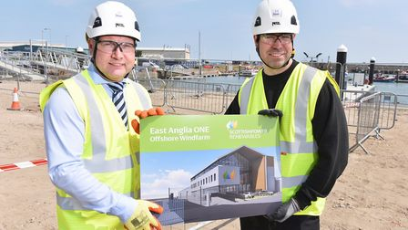 Graham Hacon, 3Sun chief executive, with Michael Montgomery, 40, the first career-switch technician