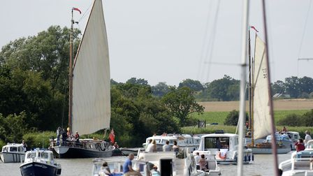 The Bishop of Norwich, The Rt Rev Graham James, arrives at St Benets Abbey by wherry on the Broads t