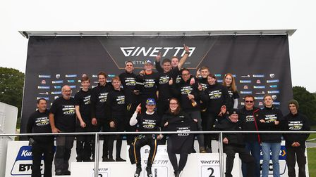Newly-crowned Ginetta Junior Champion James Hedley (sitting in the centre) and the Shipdham-based El